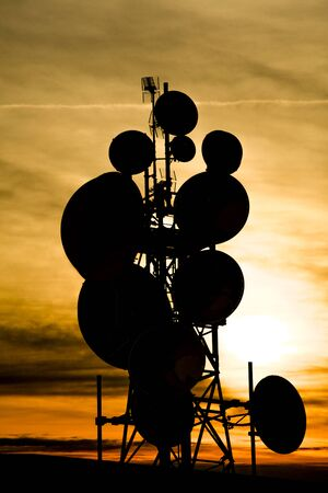 a Group of antennas for digital transmissions at sunset