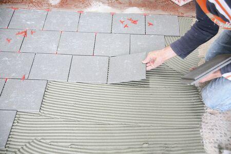 a tiler worker at work Standard-Bild - 132782707
