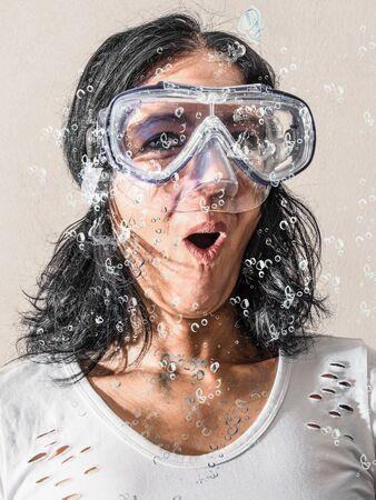 a woman having a scuba mask under water