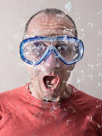 a man having a scuba mask under water