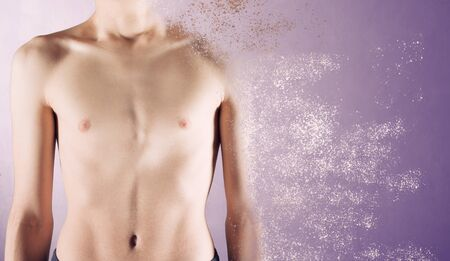 a scrawny chest of an adolescent male dissolving