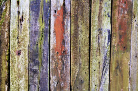 a wooden background with many color