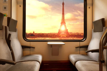 The Eiffel Tower seen from a subway car window at sunset Archivio Fotografico