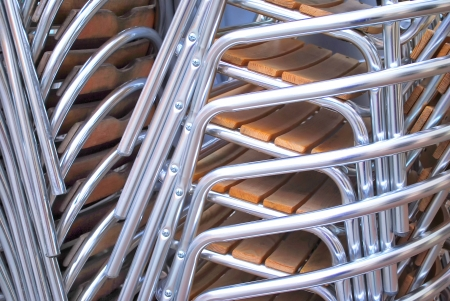 in the beer-garden stacked chairs Stock Photo