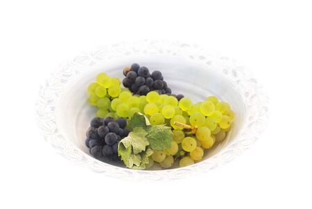 Grapes served in a porcelain dish Stock Photo