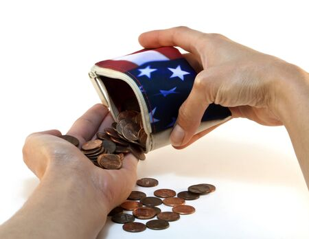 Female hand holding an American flag wallet spilling one cent coins and pennies into the other hand isolated on white background. Stock Photo - 13854638
