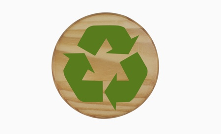 Green Recycling symbol sign on circle wood photo