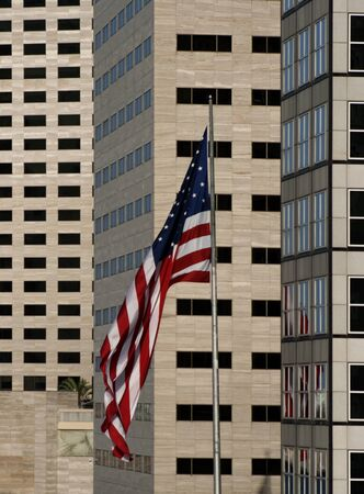 American Flag in front of buildings in urban downtown metropolis city.  photo