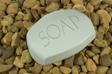 scrubbing up: Soap Bar on multi colored stones background
