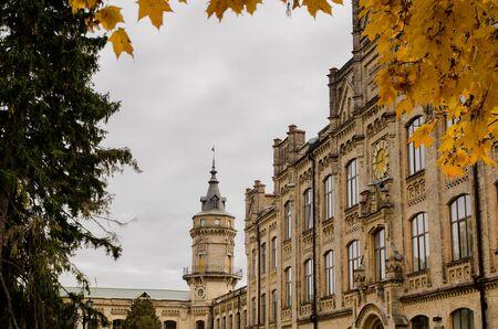 technical university: KIEV, UKRAINE - NOVEMBER 08: The old clock of Kiev Technical University shows the golden city autumn. 08 November 2015 Kiev. Ukraine Editorial