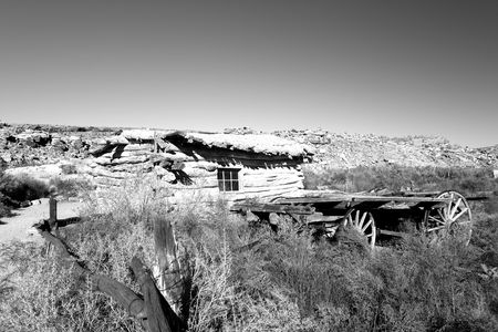 Black & white of an old Homestead and wagon in Arches National Park Utah