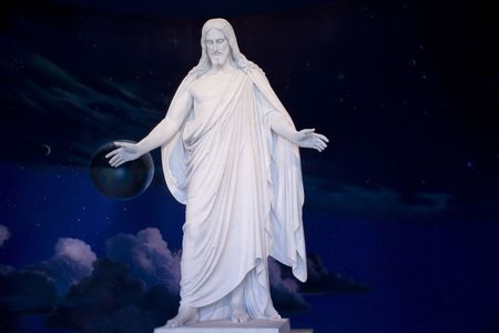 Jesus standing with the Universe behind him.  Stars and planets Stock Photo