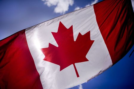 Canadian flag is tattered as Canadian troops Stock Photo