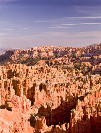 Deep amphitheaters filled with flame-colored rock formationa called hoodoos are the hallmark of Bryce Canon National Park.