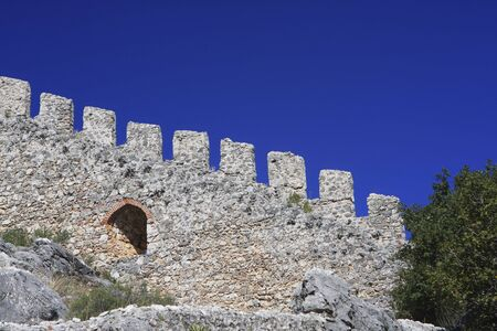 A double line of defensive walls munt the promontory to enclose the Citadel (Kale) inside which is a Byzantine Church.