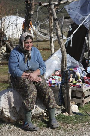 Nomadic woman selling her hand made goods