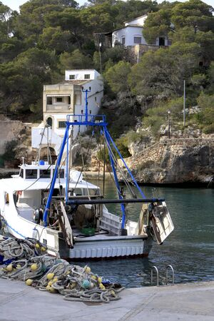 Fishing boats  in Mallorca Spain. Boats coming in after a day of fishing in Mallorca Spain Stock Photo