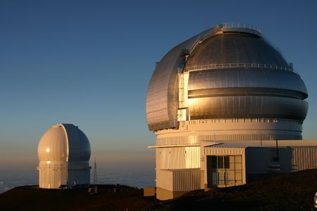 A beautiful sunset on top of Mauna Kea looking at the Observatories on the Big Island of Hawaii Stock Photo