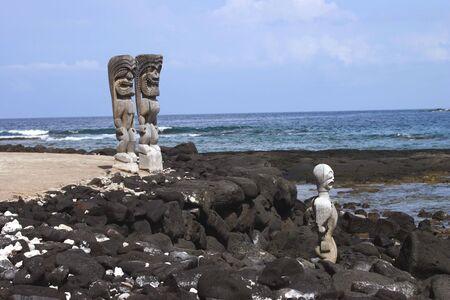 idols: Three Idols over looking the beach on the Big Island of Hawaii