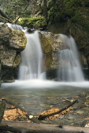 Waterfall cascading a 15 foot rock face Stock Photo