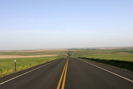 on both sides: Montana highway with fields on both sides Stock Photo