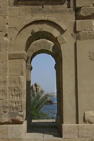 roman soldiers: An Arch in Philae Temple on the Nile in Egypt. Look close at the long indents in the wall where the Roman soldiers sharpened their swords. Stock Photo