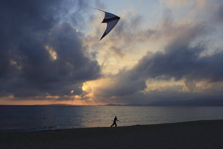 mallorca: Kite flying in Mallorca Spain at sunset Stock Photo