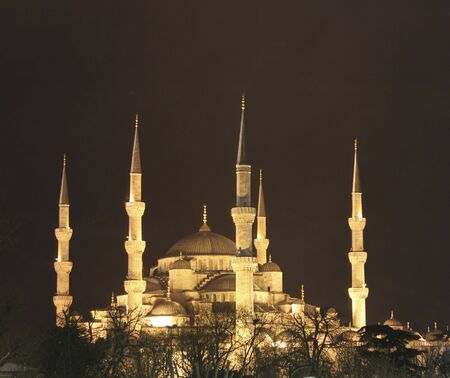 Golden lights of the Blue Mosque against the black sky