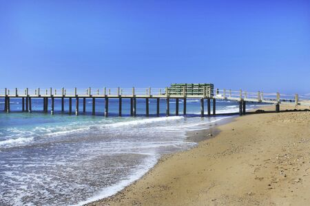 Beach with dock on the Mediterranean Sea Stock Photo