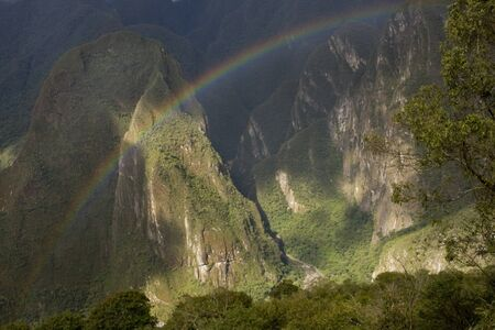 A rainbow over Machu Picchu Valley in Peru, South America Stock Photo