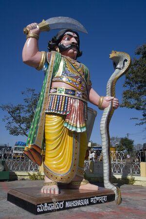 dura: Mahishasura Mardhini, the one who vanquished the demon Mahishasura, Chamudeeswari, or Dura is the fierce form of Shakti.  Colorful gigantic image of the demon.  Found at summit of Chamundi Hill.