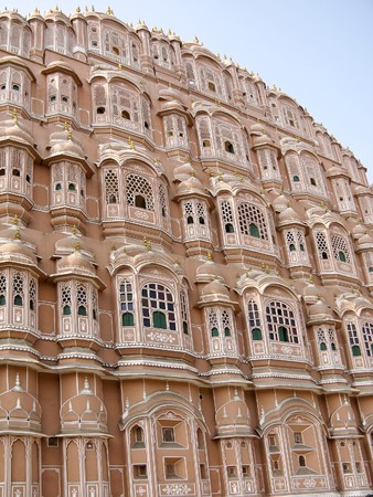 Hawa Mahal is a palace in Jaipur, India. Build in 1799, it forms part of the City Palace and was the womens quarters (harem) designed to provide the residents with discreet views of the street below.  Stock Photo