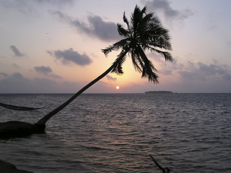 Sunset on a tropical beach on Maldives Islands Stock Photo