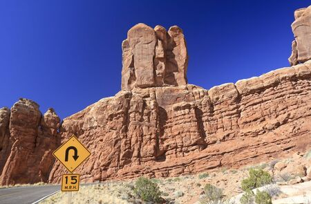 curve: Sharp curve sign in Arches National Park