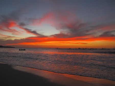 Sunset in Costa Rica.  Toned sunset image with good depth of field and slow shutter to capture the motion of the ocean