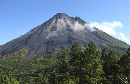 Volcano Arenal in Costa Rica on a clear day. Smoke & steam coming out from just below the top cone. Northeastern slopes.
