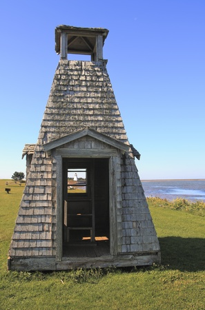 See the Lighthouse through playhouse, Woods Island, PEI, Canada