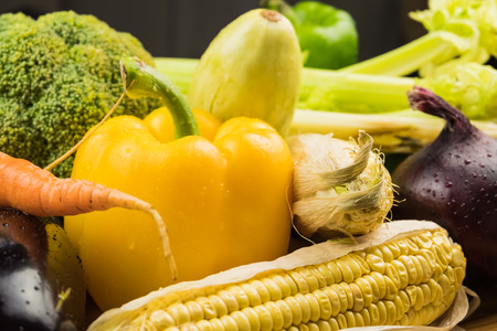 Locally grown bell pepper, corn and other natural vegan food laying on table. Close-up of fresh organic vegetables Stock Photo
