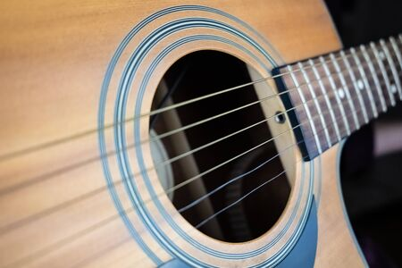 Trembling guitar string, electronic shutter distortion effect. Close-up image of resonating strings captured with wave effect