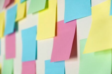 Sticky paper notes on a planning board, close-up view. Planning, brainstorm, diversity or fresh ideas concept - pattern of empty multicolored paper notes Stock fotó
