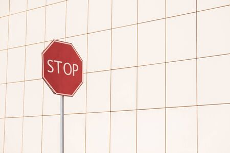 Stop sign in geometric pattern background. Street photo of a road sign with copy space