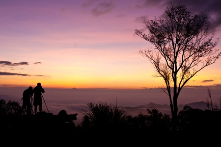 Young men silhouette taking photos about landscape outdoor  Stock Photo - 9923685