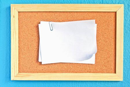 skyblue: notepad on cork board on sky-blue background Stock Photo