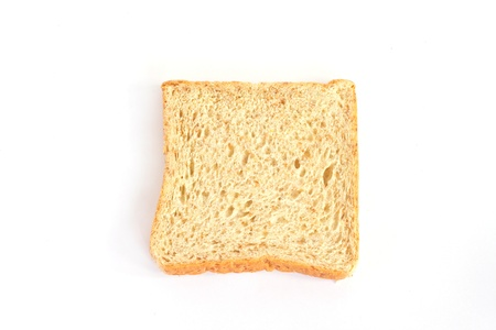 Piece of whole wheat bread isolated on white.