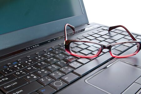 bussiness time: Eyeglasses on the laptop. Concept  Stock Photo