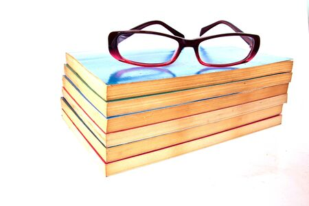 old  book and  eyeglass isolated on a white background  photo
