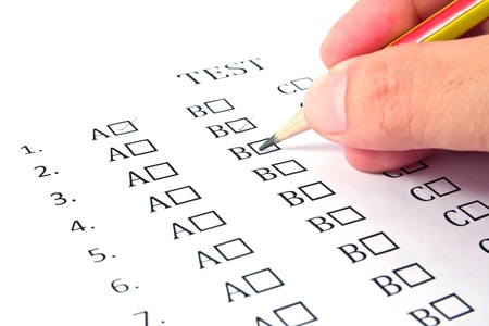 Hand choosing the test list on the examination  Stock Photo