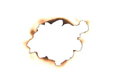 burnt hole in a paper  Stock Photo - 10871038