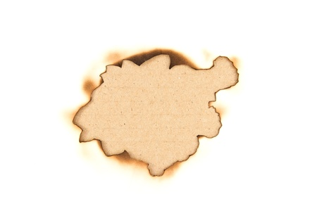 Burnt hole in a paper over brown paper background Stock Photo - 10919747