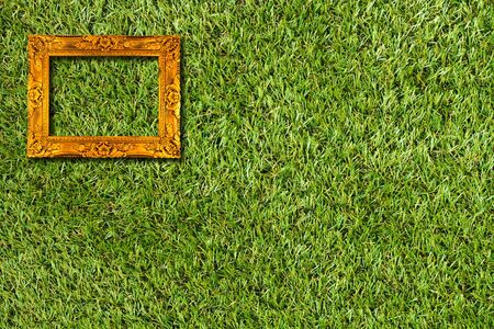picture frame on artificial grass field background photo